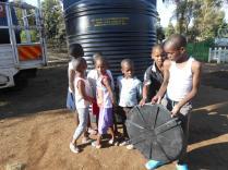 Children receiving tank donation