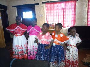 Children in new Christmas clothes