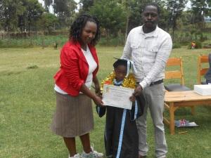 Peter graduating from nursery school